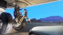 File:Nate jumping on Plane wheels.jpg