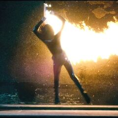 Selene jumps over a flamethrower.