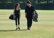 Rose and Dimitri walking back after practice