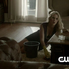Rebekah cleaning the floor