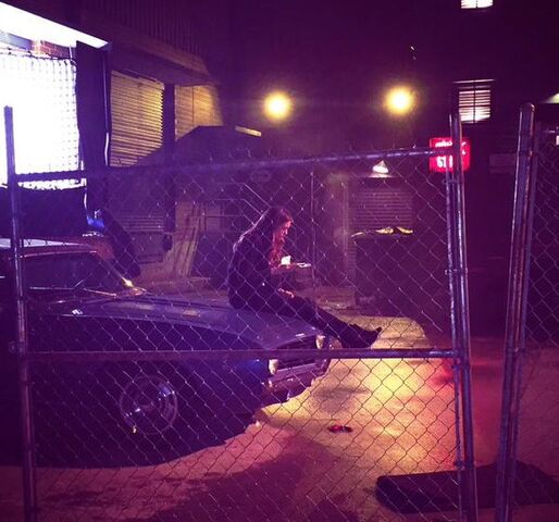 File:6x22 Elena's sitting on Damon's car.jpg