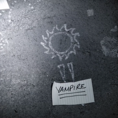 Symbol for vampire: Sun with fangs under it.