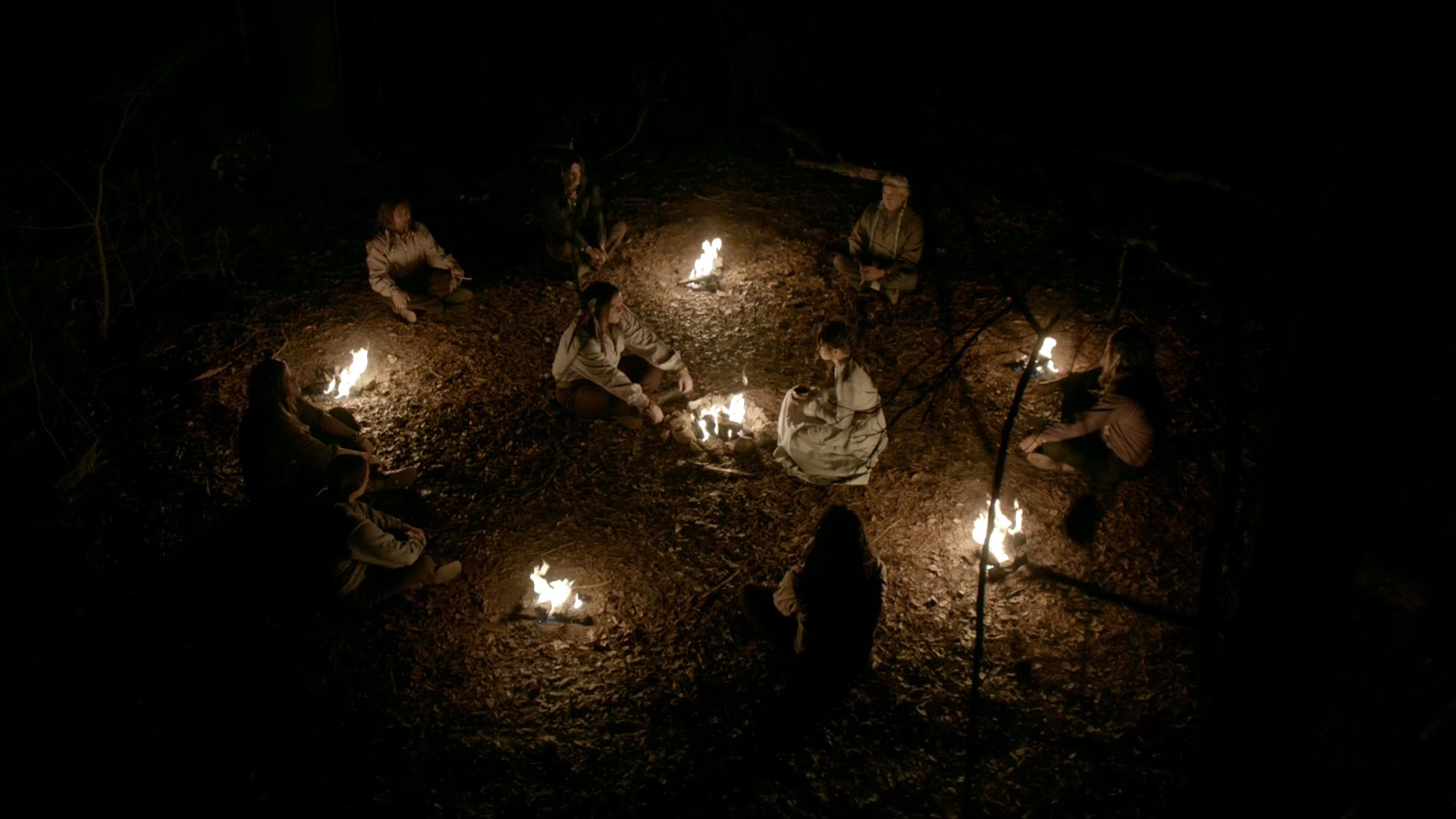 Shamans perform their ritual on Rayna.