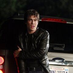 Damon pretending to have hurt his arm.