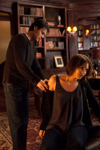 File:Damon checking Rose's wound.jpg