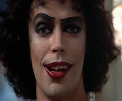 Dr. Frank-N-Furter smirking evilly