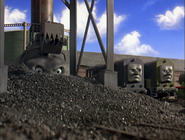 Splatter and Dodge looking ashamed with their boss covered in coal dust