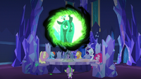Queen Chrysalis appearing in the communication window by her changelings tooking the form of Twilight and her friends including Spike