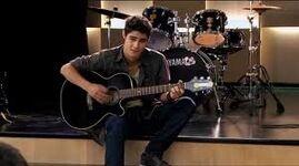 Tomas playing guitar