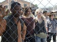 Bob Maggie Beth and the group looking at Hershel