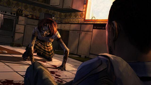 File:Walking dead video game feb 15 2012 screenshot one of 3 zombie on floor.jpg