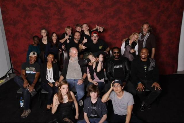 File:Casts of twd with emily in the middle while being kissed by norman and scott watches.JPG