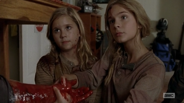 File:Lizzie and Mika holding Tyreese.png