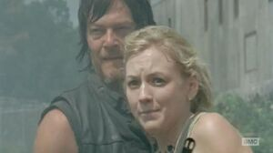 Daryl and Beth looking at the prison and is about to go