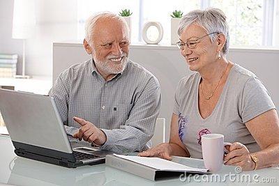 File:Senior-people-using-laptop-smiling-20855479.jpg