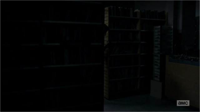 File:5x05 Shelves As Barricade.png