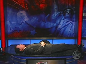 Colbert-lying-on-desk