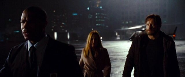 File:Mosley Drummy leads Dana Scully and Fox Mulder.jpg