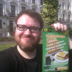Simon with a toaster bag.