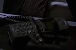File:2x20 Mike sat phone.jpg