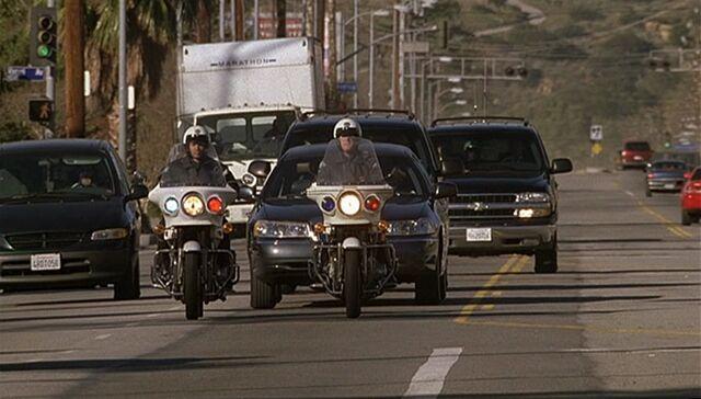 File:1x14 motorcade.jpg