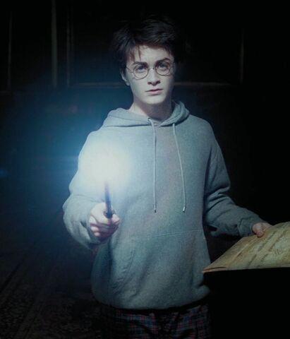 File:Harry casting the Wand-Lighting Charm.jpg