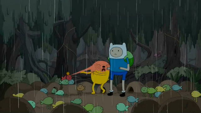 File:S4 E23 Jake being squirted by frog person.png
