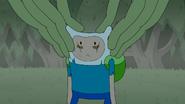 S4e23 Mega Frog pinching Finn's ears