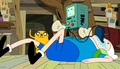 S5e6 BMO w bread standing on Finns belly.png