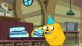 S6e16 Jake gobbling up cake.png