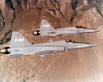 749px-Two f-20 in flying