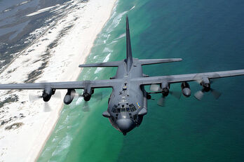 800px-AC-130H flies along Northwest Florida coast