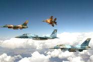 800px-Nellis Flight, 5 June 2008 Aggressor F-15s and F-16s