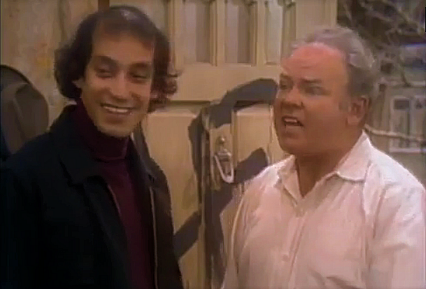 File:AITF ep 3x20 - Paul laughs at Edith's joke as Archie stifles her.png