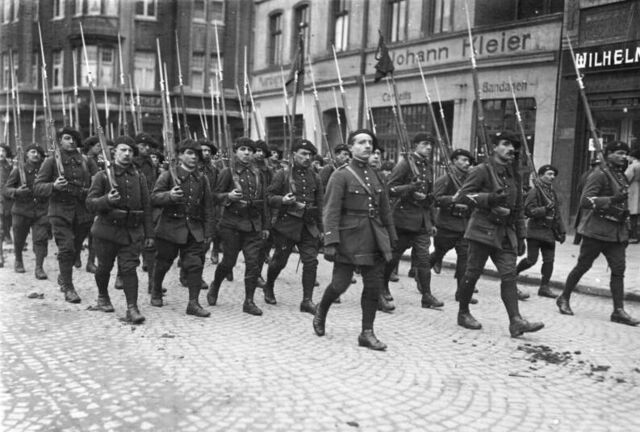 File:French forces marching thro Buers, Germany.jpg