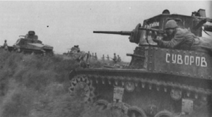 A Soviet rifleman getting a ride from a tank moving in the Romanian lowlands east of the Transyvanian mountains.