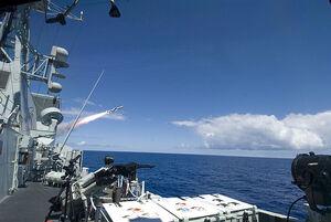 Frigate firing harpoon