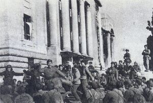 A group of soldiers dancing in front of a building