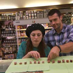 Brendon &amp; Rachel doing the <i>Name That Salami</i> Detour in <a href=