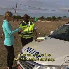 Caroline is given a speeding ticket.