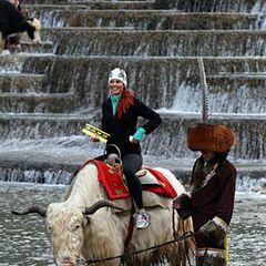 Jaime riding a Yak in <a href=
