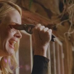 Cordelia cuts her new eyes with a pair of gardening shears