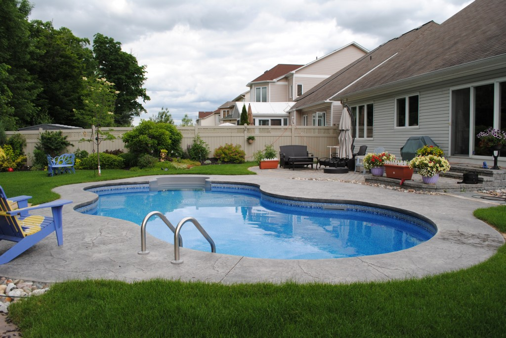 Image Backyard Swimming Pool Designs With Blue Purify Water At Yard With Safety Sid Hand Grip