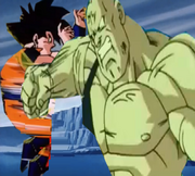 Spopovich punchs teen gohan in the the stomach