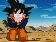 Goten grabing his arms around his stomach