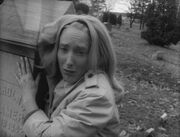 Judith O'Dea clutching grave in Night of the Living Dead bw