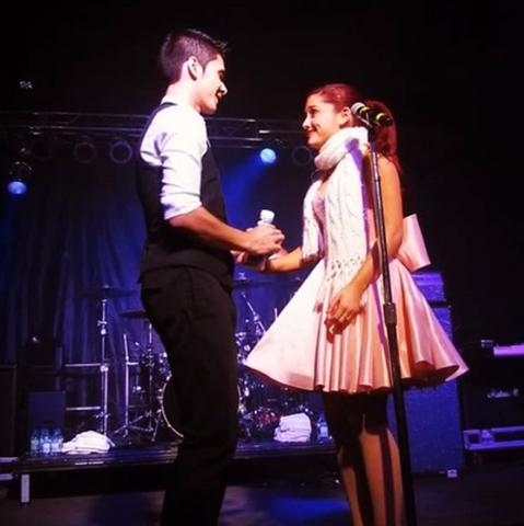File:Jordan handing Ariana water.png