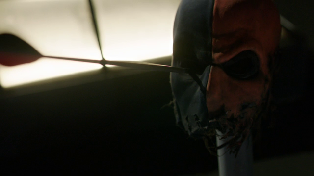 File:Slade taunts Oliver with his mask.png