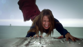 Supergirl pulling the ship away from the National City Port.png