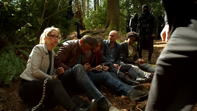 File:Team Arrow tied up on Lian Yu.png